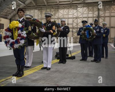 Joint Base Elmendorf-Richardson service members present wreaths at a POW/MIA recognition ceremony at Hangar 1, JBER, Alaska, Sept. 21, 2018. POW/MIA recognition day is observed every year on the third Friday in September and honors those who were prisoners of war and those who are still missing in action. - Stock Photo