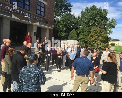 PHILADELPHIA (Sep. 27, 2018) – Newer employees of NAVSUP Weapon Systems Support gather at the front steps of NAVSUP WSS's Building 1 before being provide a tour of the aircraft adorning the front lawn of the building.  The tour was part of a week-long NAVSUP WSS academy recently held in late September to provide employees a better appreciation and understanding of the organization and its role as the Navy's Program Support Inventory Control Point. Nearly 50 NAVSUP WSS employees gathered for the 48th NAVSUP WSS Academy, held in Philadelphia. - Stock Photo