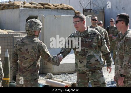 Laghman Province, Afghanistan (October 27, 2018) – Gen. James C. McConville, Vice Chief of Staff of the Army, greets Staff Sgt. Dylan Walsh, a cannon crewmember and Las Vegas, Nevada native from 2nd Battalion, 12th Field Artillery Regiment, 1st Stryker Brigade Combat Team, 4th Infantry Division during his visit to Train, Advise, assist, Command East headquarters. - Stock Photo