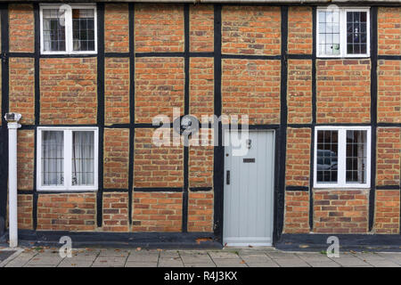 Old Timbers, a half timbered brick built cottage part of a terrace, Well Street, Buckingham, UK - Stock Photo