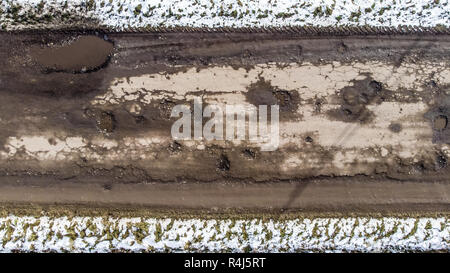 Destroyed road, difficult traffic area, threat of traffic accident. Ukraine - Stock Photo