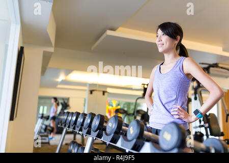 Woman trainging in gym - Stock Photo