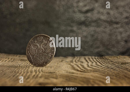 Closeup of old russian coin on a wooden background. - Stock Photo