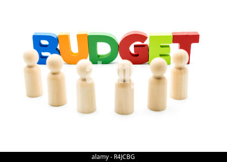 Wooden figures posing as business men in front of the word BUDGET, high key isolated on white. - Stock Photo