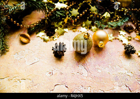 New Year or Christmas decorations isolated on a yellow background, bokeh effect.Celebration, greeting card,christmas tree concept. Selective focus,copy space. Christmas composition with gold balls, garlands and sparkling stars. - Stock Photo