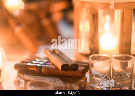Cigar and rhum rum to end the night in friednship with men's things related. Bokeh and defocused image for conceptual mood about males - Stock Photo