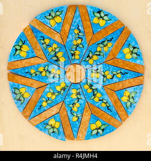 Ravello, Italy - June 16, 2017: Close up of a ceramic table top sold in Ravello, Italy - Stock Photo