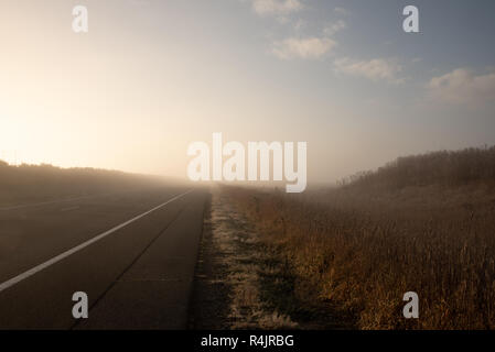 Misty road in the Australian country outback of New South Wales - Stock Photo