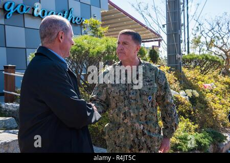BUSAN, Republic of Korea (Oct. 30, 2018) U.S. Rep. William McClellan 'Mac' Thornberry, chairman of the House Armed Services Committee (HASC), shakes hands with Rear Admiral. Michael E. Boyle, commander, U.S. Naval Forces Korea (CNFK). Thornberry's visit to CNFK is a part of an overall site visit to the Korean peninsula to meet with U.S. military components and gain a better understanding of the U.S. and ROK alliance. - Stock Photo