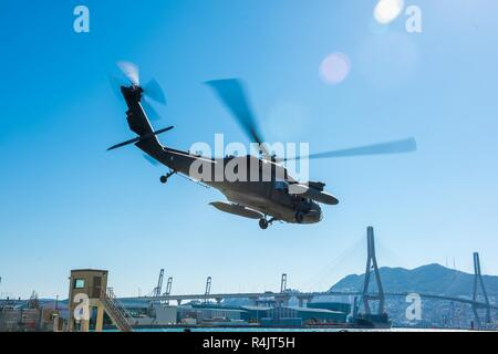 BUSAN, Republic of Korea (Oct. 30, 2018) U.S. Rep. William McClellan 'Mac' Thornberry, chairman of the House Armed Services Committee (HASC), departs from the Military Sealift Command (MSCO) in Busan via UH-60 Blackhawk helicopter. Thornberry's visit to MSCO is part of an overall site visit to the Korean peninsula to meet with U.S. military components and gain a better understanding of the U.S. and ROK alliance. - Stock Photo