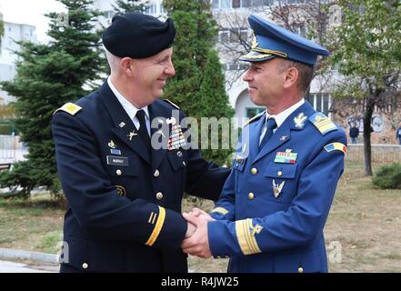 U.S. Army Col. Dale Murray, Black Sea Area Support Team commander, greets Romanian army Capt. Mihai Pricopie during the 140th anniversary of the Romanian 9th Mechanized Brigade at the House of Culture Park, Constanta, Romania, Nov. 1, 2018. The U.S. Army is committed to working with our European allies to share the responsibilities of defense by enhancing professional relationships and training. - Stock Photo