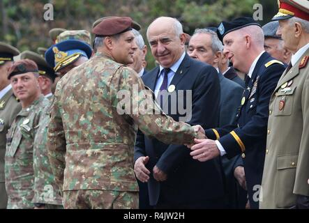 Romanian army Brig. Gen. Toma Dorin, commander of the Romanian Operational Army Component, greets U.S. Army Col. Dale Murray, Black Sea Area Support Team commander, during the 140th anniversary of the Romanian 9th Mechanized Brigade at the House of Culture Park, Constanta, Romania, Nov. 1, 2018. The U.S. Army is committed to working with our European allies to share the responsibilities of common defense by enhancing professional relationships and training. - Stock Photo