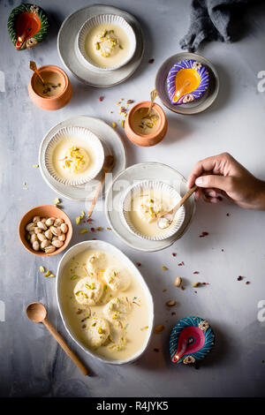 Ras malai, an Indian sweet delicacy, having a rich cheesecake texture - Stock Photo