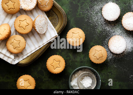 Christmas fruit mince pies dusted with icing sugar. - Stock Photo