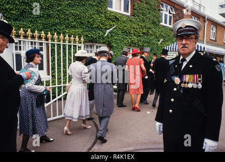 Ascot Races England UK 1986 scanned in 2018 the British Royal Family arrive and walk about at Royal Ascot in 1986 Members of the public dressed in fine hats and top hats and Tails for the men at Royal Ascot. - Stock Photo