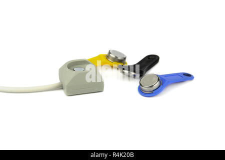 electronic ID iButton (Touch Memory) and the reader on a white background - Stock Photo