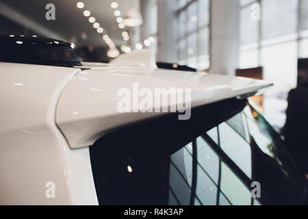 rear window of the car, spoiler with brake light in raindrops. - Stock Photo