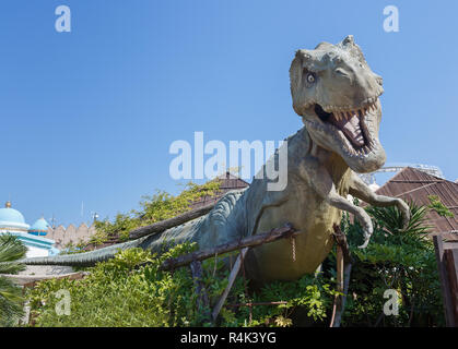Castelnuovo del Garda, Italy - Agust 31 2016:  Dinosaur statue Yrannosaurus-rex Gardaland Theme Amusement Park in Castelnuovo Del Garda, Verona, Italy - Stock Photo