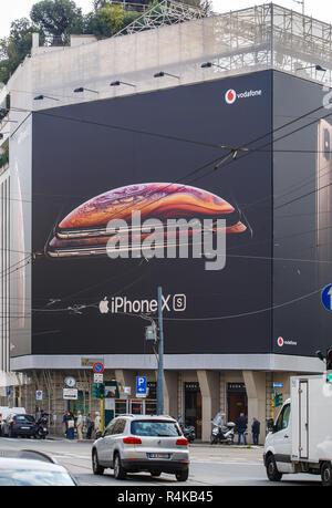 MILANO,ITALY-10 OCTOBER,2018: New Apple Iphone XS advertisement banner on Apple Store in Italian city street.Luxury smart phone Ten S model - Stock Photo