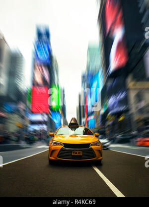 Famous Yellow Taxi Cab Drives Through Times Square Manhattan In New York With Dramatic Modern Effect - Stock Photo