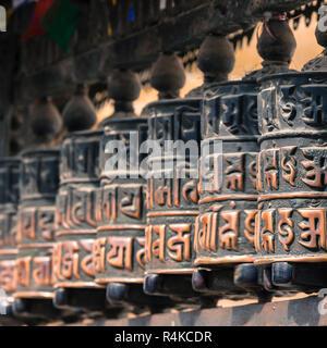 Buddhist prayer wheels, Kathmandu, Nepal. - Stock Photo