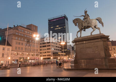 ZAGREB, CROATIA - 09 OCTOBER 2018: Zagreb's main square with Ban Josip Jelacic statue and surrounding buildings on a wet evening. - Stock Photo