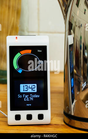A Geo Smart Meter provided by EDF Energy in a domestic kitchen.  Shows cost of energy consumed during day. - Stock Photo