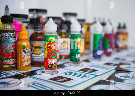 KIEV,UKRAINE-27 OCTOBER,2018: Plastic bottles with e-liquids for smoking tobacco with tasty fresh flavor.Buy new bottle with vape juice,quit smoking n - Stock Photo