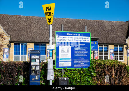 Pay and display ticket machine in a car park in East Grinstead, Sussex. - Stock Photo