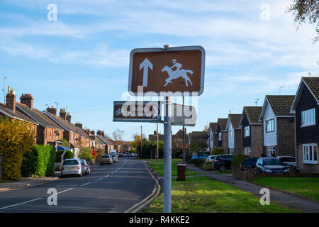 Lingfield horse racing and Surrey Cycleway signs in Lingfield, Surrey, UK - Stock Photo