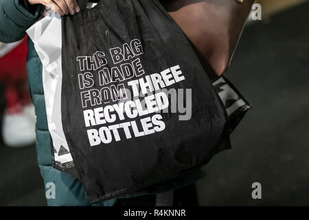 Recycled plastic bottle product,  made from 100% coated cotton canvas on the exterior and rPET (a nylon-like material made from recycled plastic bottles) on the interior lining. rPET stands for recycled polyethylene terephthalate. Bags for Life at Southport, Merseyside, UK - Stock Photo