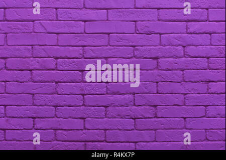 ultraviolet brick wall painted at saturated purple colour. closeup texture background - Stock Photo