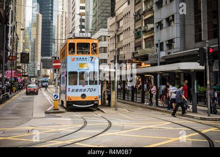 Street scene with trams in Sheung Wan, Hong Kong - Stock Photo