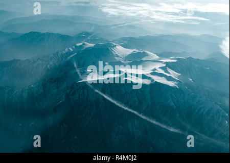 Photo of winter mountain view from plane window. Shot in the Kasakhstan tanshan mountains - Stock Photo
