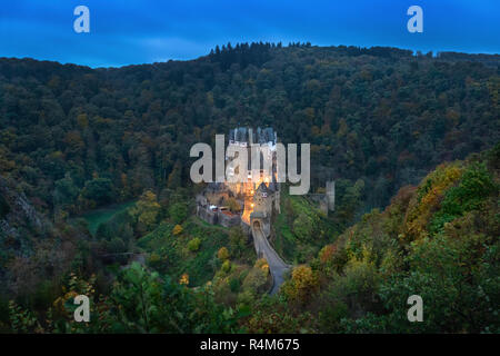 Eltz Castle at dusk - famous hilltop castle nested in the forest hills above the Moselle River between Koblenz and Trier, Germany - Stock Photo
