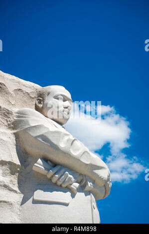 WASHINGTON DC - AUGUST, 2018: The stone portrait at the civil rights leader Martin Luther King, Jr memorial looks out under bright blue sky. - Stock Photo