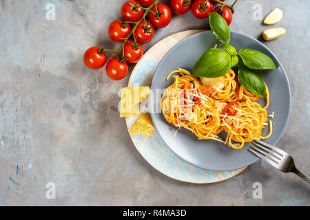 Top view of plate with spaghetti on grey background - Stock Photo
