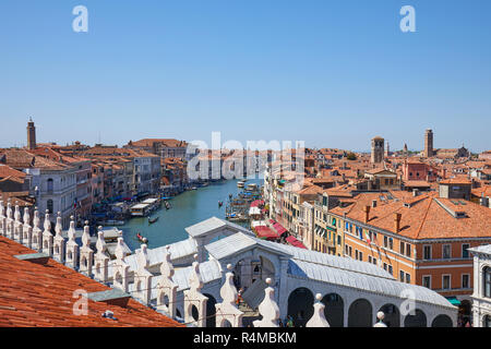 VENICE, ITALY - AUGUST 15, 2017: Grand canal and Rialto bridge view from Fondaco dei Tedeschi, luxury department store terrace in a sunny summer day - Stock Photo