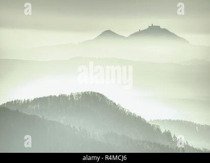 Fantastic hilly landscape with high humidity in the air. Mountain forest in clouds landscape. Foggy countryside - Stock Photo