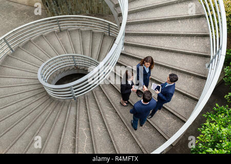Top view of business people standing on step - Stock Photo