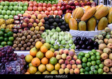 Farmers produce market, group of various locally grown fresh fruits on display in Costa Rica. - Stock Photo