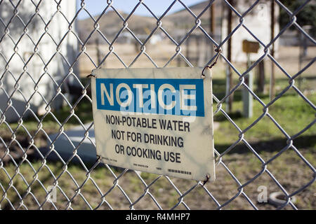 Warning sign about non-potable water in An Alpine, Texas, city park. - Stock Photo