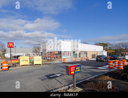 McDonalds fast food restaurant being remodeled with drive thru open and dining room closed signs in Falmouth, Cape Cod, Massachusetts USA - Stock Photo