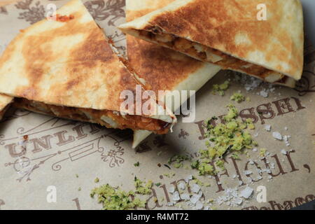 A shot of a tortilla sandwich cut in several pieces - Stock Photo