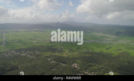 Mountain valley with river, farmland, rice fields. Aerial view of Mountains with green tropical rainforest, trees, jungle with sky. Philippines, Luzon. - Stock Photo