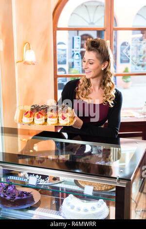 Female baker in confectionery - Stock Photo