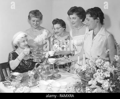 Society women gather for a tea party in the afternoon in California, ca. 1960. - Stock Photo
