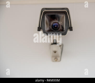 Straight on view of a modern surveillance camera - Stock Photo