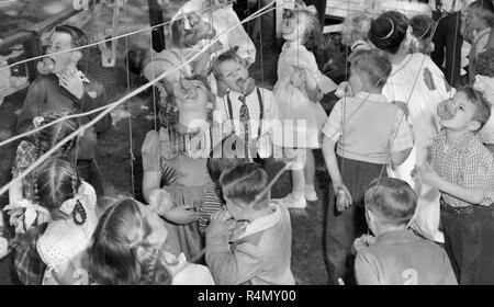 Scene from a classic child's backyard birthday party in California, ca. 1949. - Stock Photo