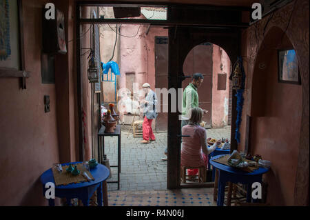 18-04-11. Marrakech, Morocco.  Street scene in the medina, photographed from inside a cafe looking out. Photo © Simon Grosset / Q Photography - Stock Photo